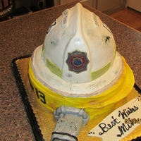 "Chief's Retirement hose is WASC, with Dark Chocolate BC and covered in fondant with RKT ""tip"", Helmet is Chocolate fudge cake, very vanilla bc and..."