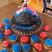 Monster High Doll Cake With Coordinating Cupcakes   Monster High Doll Cake with coordinating cupcakes.