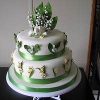 Lily Of The Valley Wedding Cake  The bride gave me a picture, so do not know whose it is. It had snowdrops on it and she wanted Lily of the valley. So changed for her. The...
