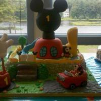 Mickey Mouse Club House Cake is 3 layers 12 x 18 x 2 vanilla cake, 2 layers of Choc. buttercream and covered in vanilla buttercream..I covered just the top of the...