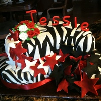 B.ack/ White This girl requested a cake with zebra stripes and stars, indicating her favorite colors were black and red. This is what I came up with.