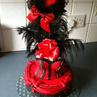 Burlesque Corset Cake sponge cake , covered with s/p using frills, swags, and bows.