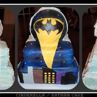 Is It Cinderella - No Batman This cake was made for a girl who loves Cinderella and Batman. She wanted both on the cake so this is what I can up with. It is all yellow...