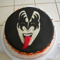 Gene Simmons Kiss Cake Red Velvet cake w/cream cheese frosting and filling. Everything else is fondant. Added glycerin to red fondant while kneeding/forming to...
