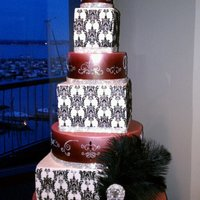 "Kim And Ryan 2011 This 7-tier cake consists of four 4"" round and three 6"" square tiers. The round tiers are fondant airbrushed with super red, then..."