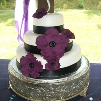 Anemone Wedding Cake Loved the colors! Eggplant anemones made of gumpaste (burgandy and royal blue makes this color - fyi!). 14, 10, 6 in. rounds covered in mmf...