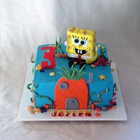 Spongebob Is Made From A Rice Crispy Treat Cake Is Iced In Buttercream And All Details Are Made From Fondant SpongeBob is made from a rice crispy treat, cake is iced in buttercream and all details are made from fondant.