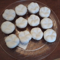 The Tooth Fairy Has Been Busy!   I made a dozen molar cupcakes for my kids' dentist. WASC cake, raspberry filling.