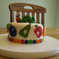 "The Very Hungry Caterpillar   First birthday smash cake. Inspired by The Very Hungry Caterpillar book. 6"" round."