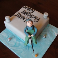 Fishing Cake for my brother - him in his new waders fishing off the end of the pier!