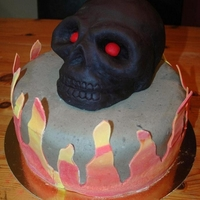 Black Skull Cake For my sons 13th birthday, he made the designe and I made the cake for him! Would love to have ideas on how to make the flames more...