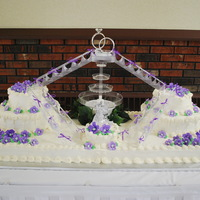 "Wedding Base of cake is 51"" x 19"" - 4 sheet cakes, with a 6"" single layer in the front, and two 8"", 12"" round tiers on the..."