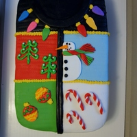 Ugly Christmas Sweater Party Cake Cake was made to look like a picture the client gave me. Red velvet cake with cream cheese buttercream covered in fondant.
