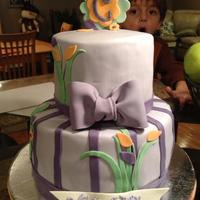 "Purple, Orange And Green Baby Shower Parden the photo bomb- This is an 8"" and 6"" buttercream flavored fondant covered cake. They gave me the mommy to be's..."