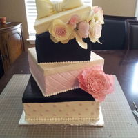 Paris Themed Graduation Party Buttercream icing, gumpaste flowers, fondant box tops. Peonies and roses made from circle and teardrop cutters. This cake was a copy of one...