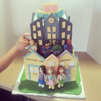 Lego Superheros Lego Friends Boy And Girl Cake Modelling Chocolate Fondant Figures Boy/Girl celebration cake, bottom tier Lego Friends in heartlake city , top are Lego superheros watching over the city (kids choose which...