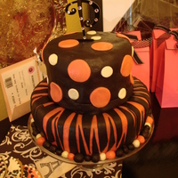 Payton's Hot Pink Zebra Cake   Red Velvet tiered cake with hot pink and black zebra stripes and polka dots covered in MMF.