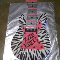 Zebra Striped Guitar Chocolate Guitar Cake covered in MMF for a 5 year olds party. I baked a large 12X18 cake and then used my son's actual guitar as the...