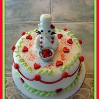 Birthday/valentines/kelly Kitty Cake  8-inch 2 layer strawberry cake with H&H strawberry filling. Little Miss Kitty gave me nothing but trouble! lol....she's alittle...