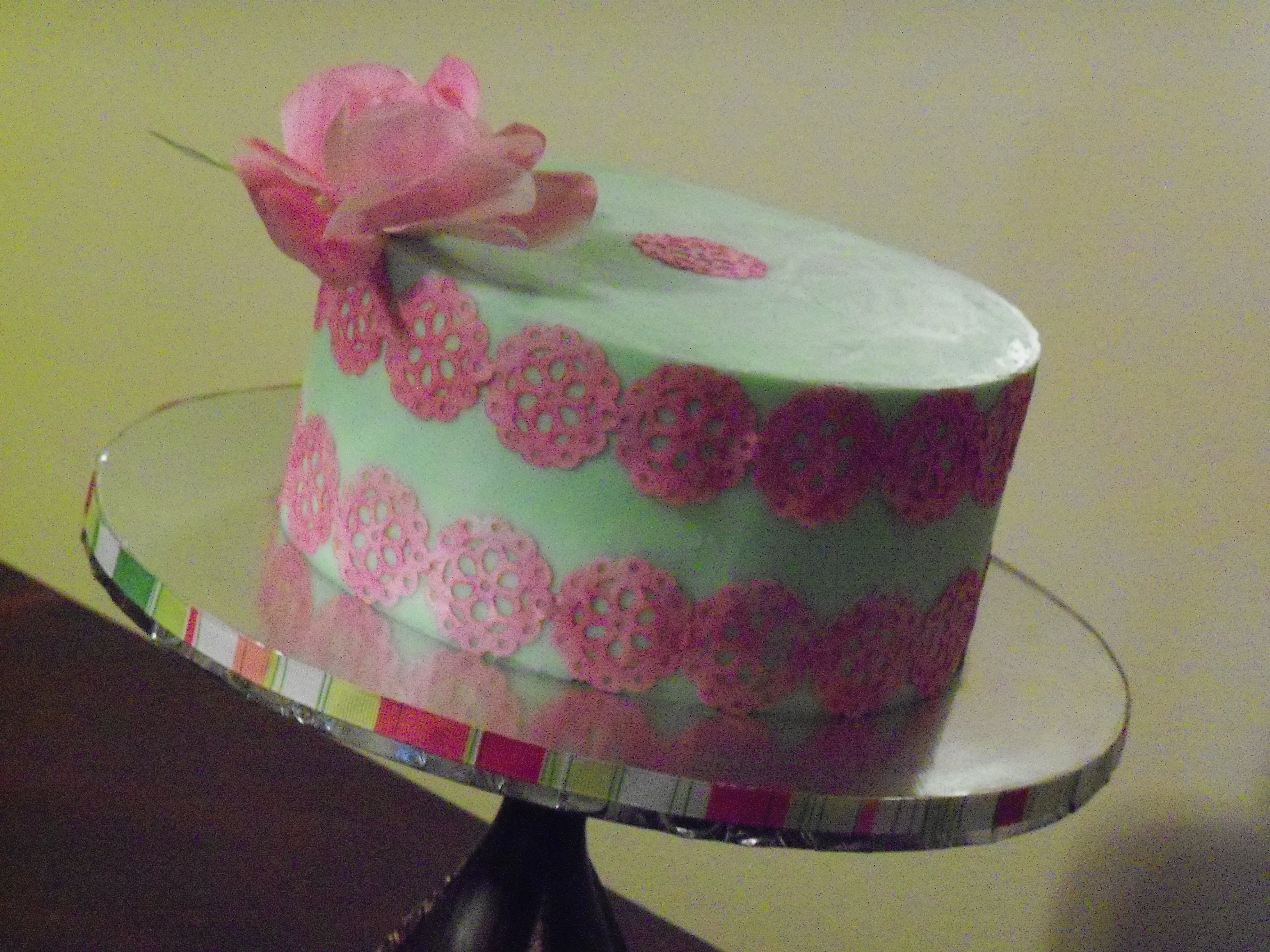 Wafer Paper Decorated Cake  I used wafer paper that I colored with petal dust. I also used a craft punch. The rose is made of wafer paper. First time trying a rose but...