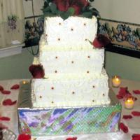 Lori And Paul's Wedding Cake Yellow cake w/ strawberry filing, and BC frosting. Real Roses.