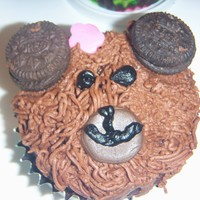 Bear Cupcakes Made for a girl having a Build A Bear party. They are iced in chocolate buttercream with fondant accents and oreo cookie ears.