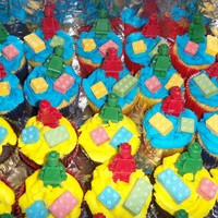 Lego Cupcakes Iced in buttercream, lego man was made with a chocolate mold and topped with lego candy.