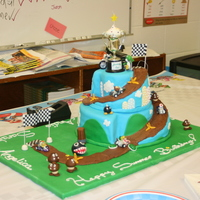 Mario Kart - Yoshi Wins The Birthday Cup!  Mario Kart - themed cake for all of the kids with summer birthdays. We bought the cars and the trophy, but made everything else (including...