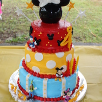 Magic Kingdom Birthday Dark Chocolate Fudge Cake bottom layer, Strawberry middle layer, dark chocolate fudge top layer. butter cream with Fondant bow for minnie...