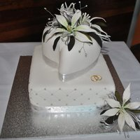 Square And Heart Wedding Cakes Bottom layer is White cake coated in white chocolate ganache covered in white fondant diamond pattern with silver cachous. Top layer is...