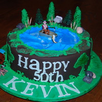 50Th Birthday Fishing Cake Chocolate Mudcake covered in Satin Ice Rich Chocolate , Blue and Green fondant.