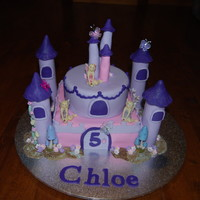 Castle Cake Bottom layer eggless Chocolate Mud cake, top layer white mud cake, cover with Satin Ice Fondant.