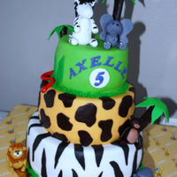 Jungle Cake This cake was for the 5th birthday of my youngest daughter.I went all out on this cake and made every animal she requested. She loved it...