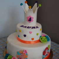Colourful Crown This cake was for a little lady that really likes the Disney princesses. I enjoyed working with the colours, it made the cake very cheerful...