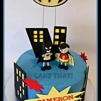 Batman & Robin WASC w/SMBC covered in MMF. Accent are mostly MMF some gumpaste. Inspired by the Pudgy Panda. TFL