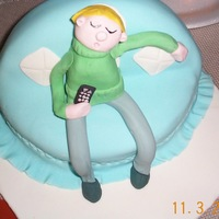 Dad Watching Football   sculped cake with fondant gumpast figure