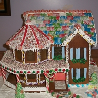 Victorian Holiday Gingerbread house poured sugar windows, gumpaste figure.