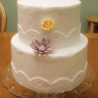 Eyelet Lace Wedding Cake The bride asked for an eyelet lace look for a border and muted colors for the mums.