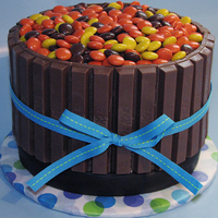 Barrel Cake Chocolate cake with peanut butter icing and decorated with KitKats and Reese's Pieces.