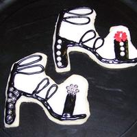 Strappy Sandal Cookies! I made these as part of an order of shoe-themed cookies! Now I want a pair for real... :) NFSC with glace. I free-hand cut the cookie dough...