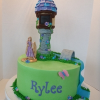 Icing Smiles - Rapunzel This cake was created for a darling little girl for the charity Icing Smiles, Inc. which provides cakes for children and their families...