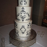 "Extra Tall Extra tall tiers, all buttercream. Bottom, 4-10"" round, middle, 4-8"" round and top is 2-6"" rounds. Delivery was 1 hour and..."