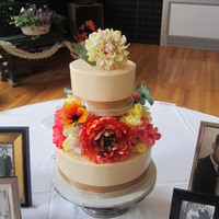 Vintage 2 tier, champagne colored buttercream with ribbons and silk flowers.