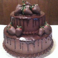"Chocolate 8"" and 12"" rounds with chocolate buttercream and chocolate glaze with chocolate covered strawberries"