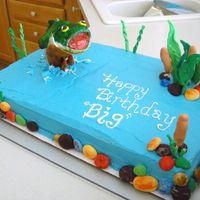 "Jumping Bass This customer ordered a sheet and personal cake and wanted them both to be ""fish related."" This was made out of buttercream and..."