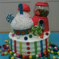 "Candy Theme Cake  Rice cereal gumball machine with glass bowl and real gumballs. rice cereal ice cream cone, fondant lollipops. The cupcake is cake 14""..."