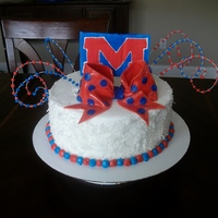 Ole Miss Hotty Toddy Birthday Cake Coconut cake with coconut custard filling. Iced with bc.