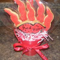 "Red Hot Cookie Bouquet Cookie bouquet baskets I made for V-day!. 6 chili peppers with a big lip cookie in center that says ""Red Hot"""