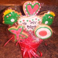 To My Prince Cokie bouquet baskets I made for V-day! 2 Frog prince cookies an X and O and 2 Heart cookies. I live how it turned out!