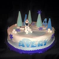 It May Be Below Freezing But Olaf Melts Your Heart! Buttercream base with fondant overlay. Sugar cone trees covered in icing and sanding sugar. So much fun to make!